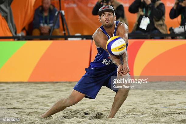 Viacheslav Krasilnikov of Russia bumbs the ball during the Men's Beach Volleyball Bronze medal match against Alexander Brouwer and Robert Meeuwsen of...