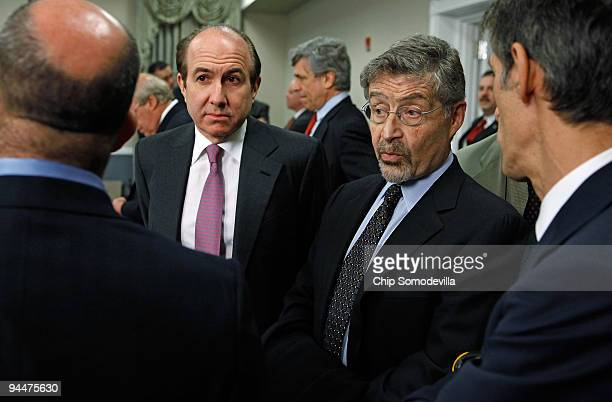 Viacom Chairman and CEO Philippe Dauman and Warner Bros Entertainment Chairman and CEO Barry Meyer talk with other executives before a roundtable...