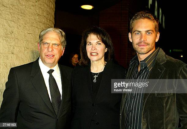 Viacom's Jonathan Dolgen Paramount's Sherry Lansing and actor paul Walker pose at the premiere of Timeline at the National Theatre on November 19...