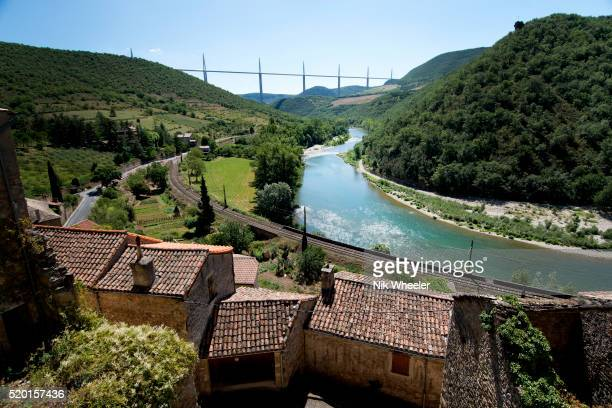 viaduc de millau in the far distance over river tarn from village of peyre france - aveyron stock pictures, royalty-free photos & images