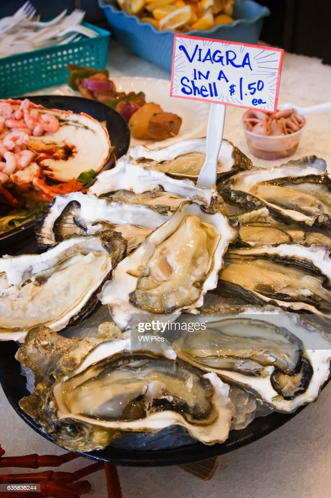 Viagra in a shell' - fresh oysters for sale at fish market on Fisherman's Wharf, Monterey, California.