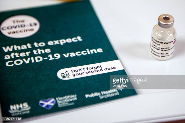 Vial of the AstraZeneca/Oxford Covid-19 vaccine is pictured next to an information booklet at the Lochee Health Centre on January 4, 2021 in Dundee,...