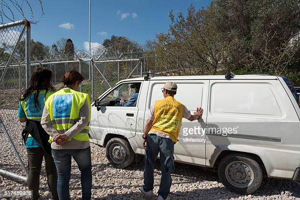 vial refugee camp gate is opened for volunteer car - deportation stock pictures, royalty-free photos & images