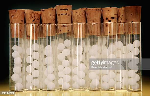 Vials containg pills for homeopathic remedies are displayed at Ainsworths Pharmacy on August 26 2005 in London British medical journal The Lancet has...