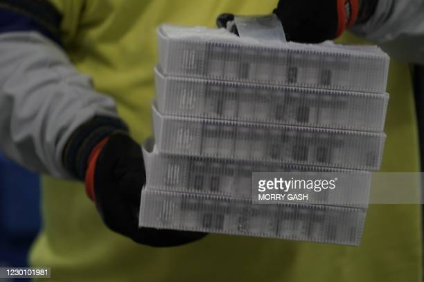 Vials in boxes containing the Pfizer-BioNTech Covid-19 vaccine are prepared to be shipped at the Pfizer Global Supply Kalamazoo manufacturing plant...