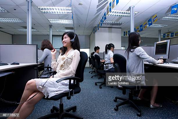 Viann Liu answers clients' phone calls at Citigroup Data Processing Center on May 26 2010 in Guangzhou Guangdong province China