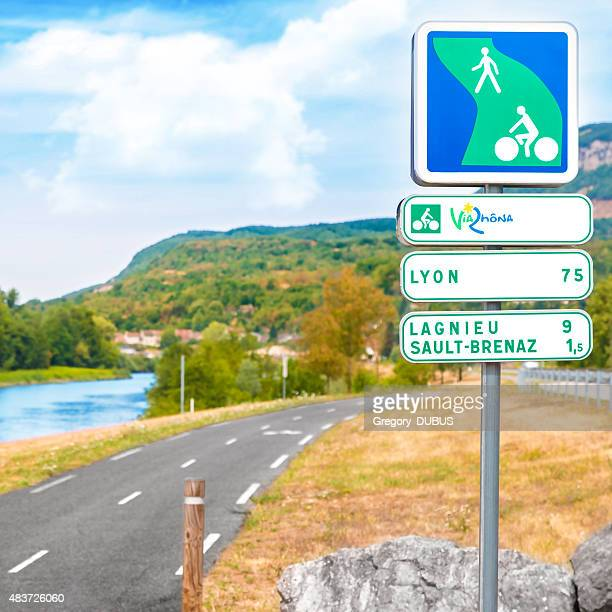 viarhona bicycle lane road sign near the rhone river rhone-alpes - rhone stock pictures, royalty-free photos & images