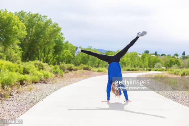 Vibrant and Lively Generation Z Female Experiencing Exaggerated Fun and Excitement Outdoors in Western Colorado on a Sunny Day