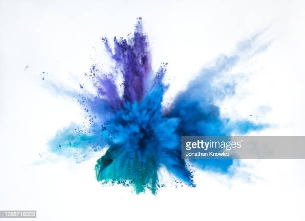 vibrant blue and purple powder explosion - white stock pictures, royalty-free photos & images