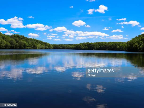 vibrant blue skies over the lake - lake george new york stock pictures, royalty-free photos & images