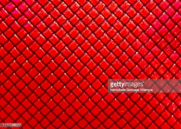 vibrant bright red textured plastic material with diagonal lines and texture. - ribbed stock pictures, royalty-free photos & images