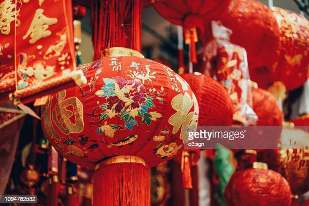 vibrant colours of lanterns, decorations and ornaments for chinese new year in celebration of luck, healthiness, happiness, reunion and prosperities - chinese new year stock pictures, royalty-free photos & images