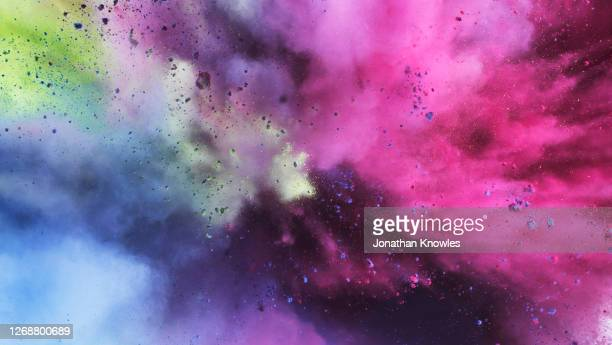 vibrant multicolor exploding powder - bombing stock pictures, royalty-free photos & images