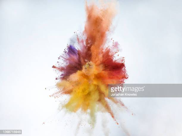 vibrant multicolor powder explosion - orange stock pictures, royalty-free photos & images