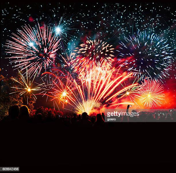 vibrant new years banner with  fireworks and cheering crowd - firework display stock pictures, royalty-free photos & images