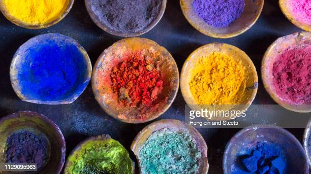 vibrant pigment powder in clay dishes - dye stock pictures, royalty-free photos & images