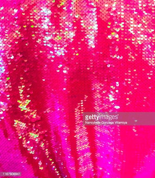 vibrant pink sequins - hot pink stock photos and pictures