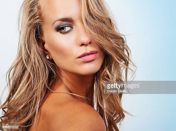 Vibrant portrait of blue eyed blonde with professional make up