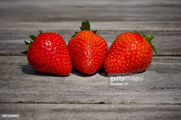 Vibrant, Red, Juicy, Ripe Strawberries on a Wooden Table