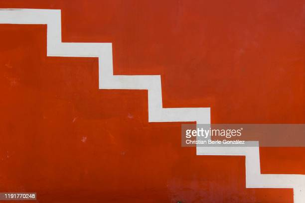 vibrant red wall of bo-kaap, cape town - south africa - christian beirle stock pictures, royalty-free photos & images