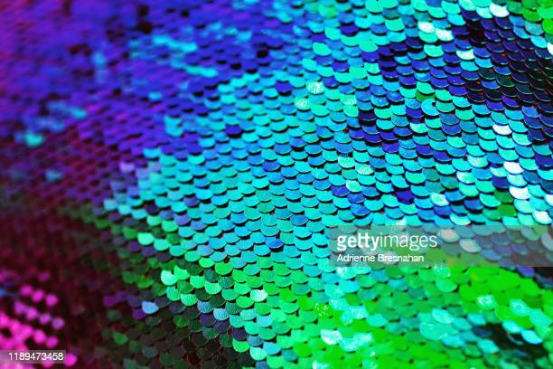vibrant sequins - sequin dress stock pictures, royalty-free photos & images