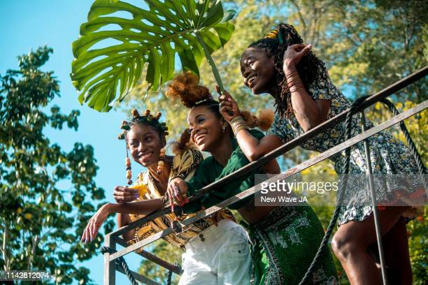 vibrant women in jamaica - afro caribbean ethnicity stock pictures, royalty-free photos & images