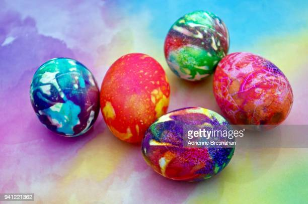 vibrantly dyed easter eggs - easter sunday stock pictures, royalty-free photos & images