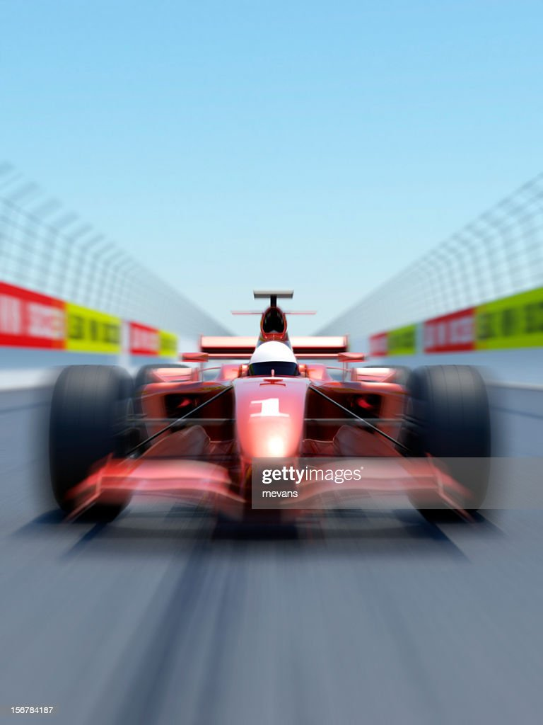 VIbrating view of a formula one racing car on a track : Stock Photo