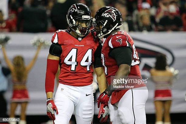 Vic Beasley Jr #44 celebrates a sack with Grady Jarrett of the Atlanta Falcons during the first half against the New Orleans Saints at the Georgia...