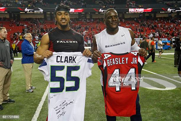 Vic Beasley of the Atlanta Falcons and Frank Clark of the Seattle Seahawks tradse jerseys after the game at the Georgia Dome on January 14 2017 in...