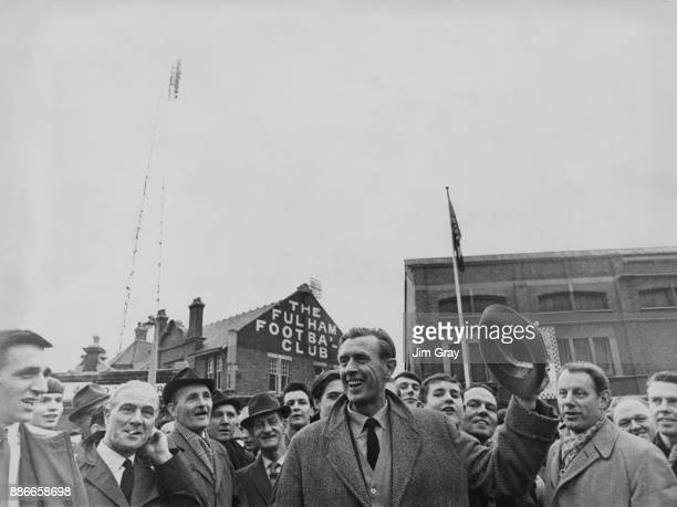 Vic Buckingham the new manager of Fulham FC is greeted by Fulham fans upon his arrival at the ground for a match against Nottingham Forest London...
