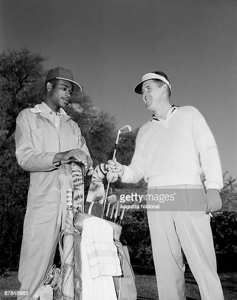 Vic Ghezzi gets a club from his caddie during the 1952 Masters Tournament at Augusta National Golf Club in April 1952 in Augusta, Georgia.