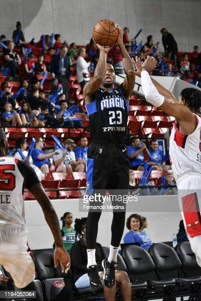 Vic Law of the Lakeland Magic attempts a three point shot against Justin Simon of the Windy City Bulls during the game on January 16, 2020 at the RP...