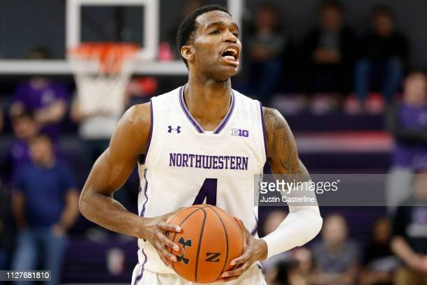 Vic Law of the Northwestern Wildcats brings the ball up the court in the game against the Penn State Nittany Lions during the second half at...