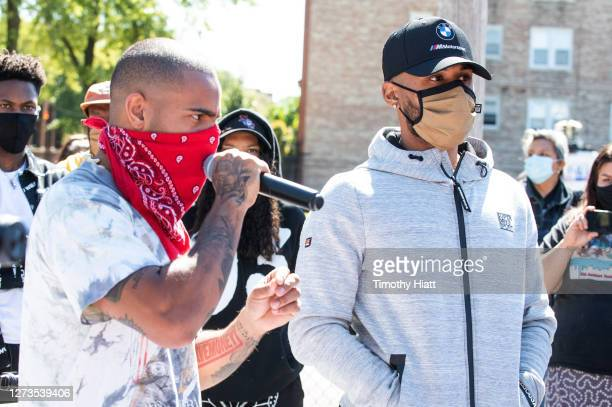 Vic Mensa and Joey Purp attend the Year Of The Youth Peace Walk Give Back Event at Overton Elementary School on September 19 2020 in Chicago Illinois