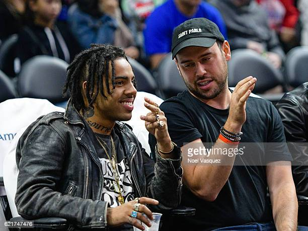 Vic Mensa and Scooter Braun attend a basketball game between the Detroit Pistons and the Los Angeles Clippers at Staples Center on November 7 2016 in...