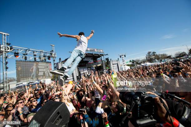 Vic Mensa crowdsurfs at the 2014 mtvU Woodie Awards and Festival March 13 2014 in Austin Texas