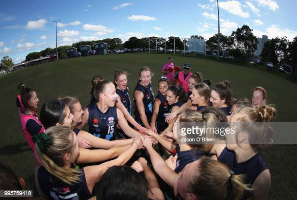 Vic Metro form a huddle during the AFLW U18 Championships match between Queensland and Vic Metro at Broadbeach Sports Club on July 11 2018 in Gold...