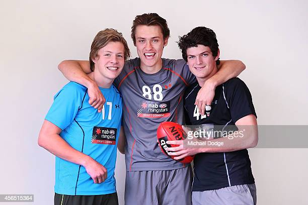 Vic Metro teamates Jordan De Goey Darcy Moore and Angus Brayshaw pose during the 2014 AFL Draft Combine at Etihad Stadium on October 2 2014 in...