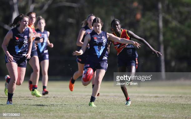 Vic Metro's Georgia Patrikios runs with the ball during the AFLW U18 Championships match between Vic Metro v Central Allies at Bond University on...