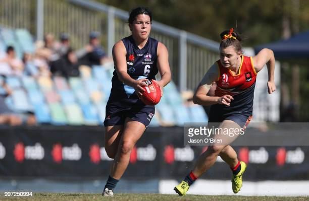 Vic Metro's Maddy Prespakis runs with the ball during the AFLW U18 Championships match between Vic Metro v Central Allies at Bond University on July...