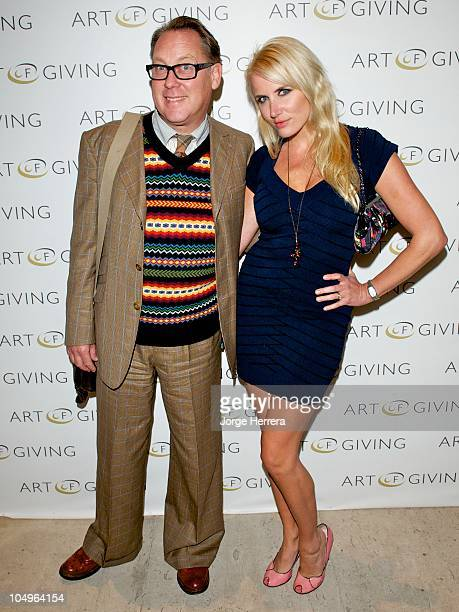 Vic Reeves and Nancy Sorrell attend the private view of 'Art Of Giving' at the Saatchi Gallery on October 7 2010 in London England