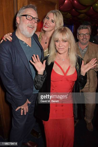 Vic Reeves Nancy Sorrell and Jo Wood attend Tramp's Christmas Party in celebration of their 50th Anniversary on December 17 2019 in London England