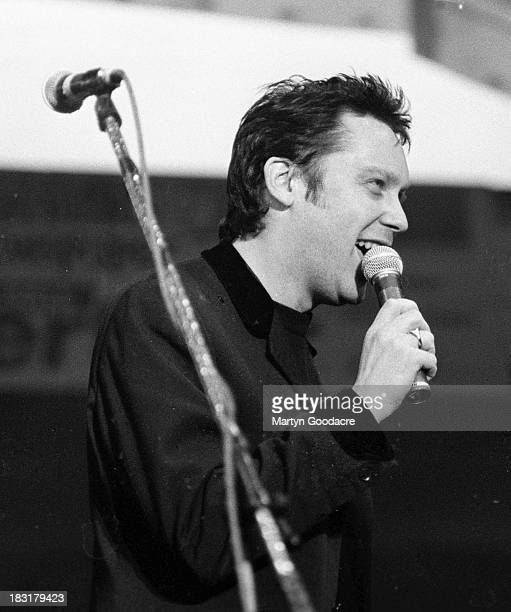 Vic Reeves performs on stage with The Wonderstuff at Bescot Stadium Walsall United Kingdom 1991