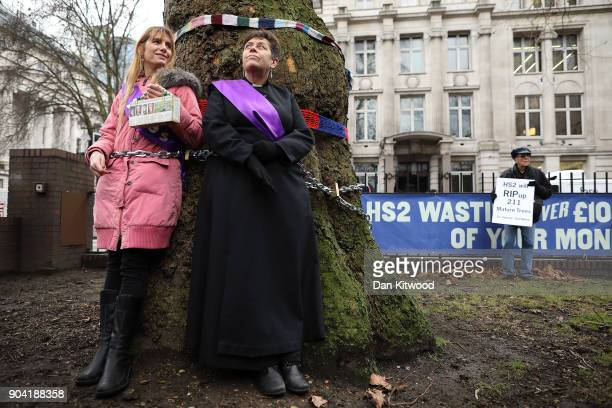 Vicar of St Pancras church Anne Stevens along another protester is chained to a tree outside Euston Station on January 12 2018 in London England The...