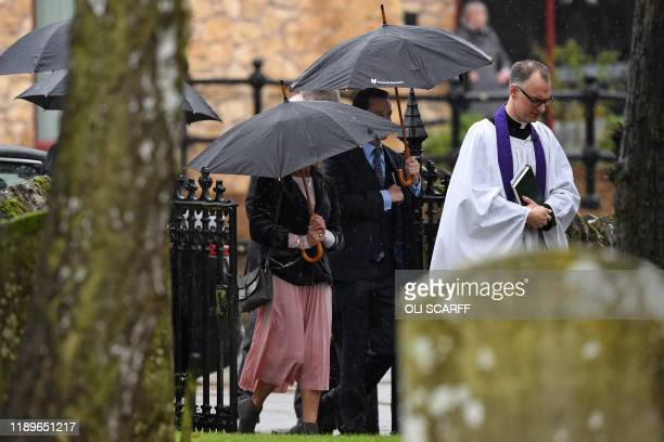Vicar Patrick Taylor leads family members of the victim of the terror attack in Fishmongers' Hall on London Bridge University of Cambridge graduate...