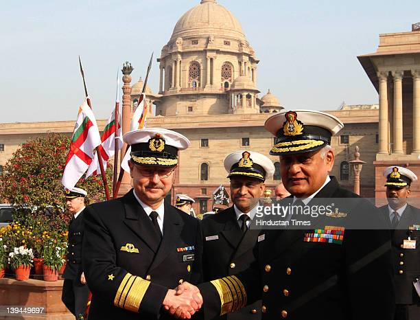 Vice Admiral Axel Schimpf Chief of Staff of German Navy shaking hand with Chief of Indian Naval Staff Admiral Nirmal Verma before inspecting guard of...
