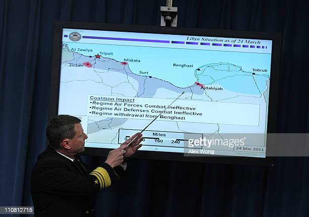 Vice Admiral Bill Gortney Director of Joint Staff points to a map of Libya during a news briefing at the Pentagon March 24 2011 in Arlington Virginia...