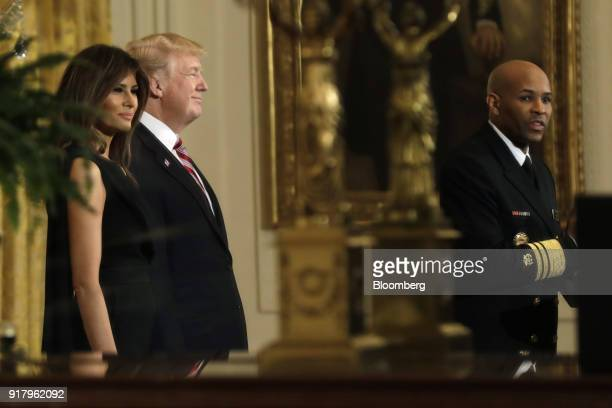 Vice Admiral Jerome Adams the US Surgeon General right speaks as US President Donald Trump second left and First Lady Melania Trump listen during a...