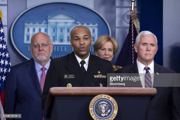 Vice Admiral Jerome Adams US Surgeon General second left speaks as US Vice President Mike Pence right Deborah Birx coronavirus response coordinator...